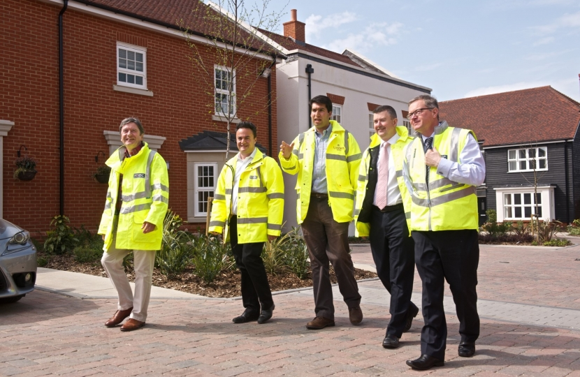 Ranil Jayawardena MP (centre), visiting new Brownfield Housing in Odiham